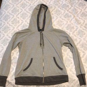Women's CHAMPION zip up sweatshirt.